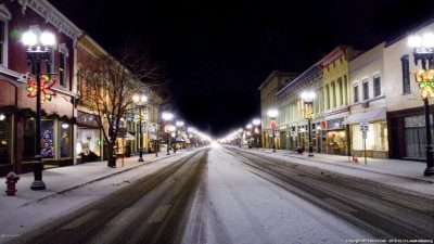 Picture of downtown Lowell, MI at night with snow on the ground
